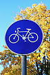Sign showing bike on background of blue sky and yellow trees in Germany stock photography