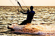 Silhouette Of A Kitesurfer On A Waves stock photo