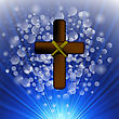 Simple Brown Wooden Cross On Blue Blurred Background