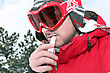 Skier Applying Lip Balm stock image