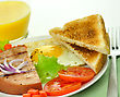Sliced Grilled Ham With Egg ,toasts ,vegetables And Orange Juice stock image
