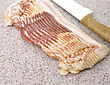 Sliced Raw Bacon And Knife ,Close Up stock photography