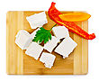 Slices Of Brine Cheese, Parsley, Slices Of Red And Yellow Sweet Peppers On A Wooden Board
