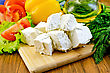 Culture Slices Of Feta Cheese, Tomatoes, Yellow Sweet Peppers, Lettuce, A Bottle Of Oil, Dill On Wooden Board stock photo