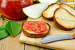 Slices Of Toasted Bread, A Glass Jar With Pear Jam, Knife On Background Wooden Board stock photography