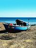 Beaches Small Boat Washed On Shore stock photo