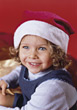 Small Girl In Christmas Hat stock photo