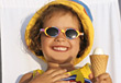 Small Girl With Sunglass & Ice Cream Grinning stock photography