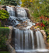 Landscape Small Waterfall At The Rivers Bank stock photo