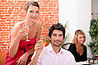 Smart Couple Drinking Champagne At A Party stock photo