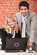 Smart Couple With A Laptop Computer And Cellphone stock photo