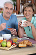 Smiling Couple At Breakfast stock image