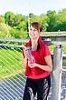 Smiling Female Runner With Bottle Of Water stock image