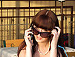 Smiling Girl In Sunglasses Talks By A Mobile Phone2 stock image