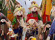 Smiling Handmade Cloth Scarecrow Dolls Displayed Together stock photography