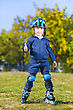 Smiling Little Skater Boy Showing Thumb Gesture stock image
