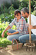 Smiling Lovers Doing Gardening stock photography