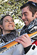Stage Smiling Young Couple At Ski stock photo