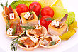Smoked Fish And Feta Cheese In Pastries And Fresh Vegetables stock photo