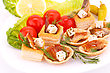 Smoked Fish And Feta Cheese In Pastries And Fresh Vegetables stock image