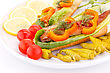 Appetizing Smoked Fish With Fresh Vegetables On Plate stock photo