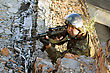 Army Sniper With A Machine Gun In An Ambush stock photo