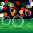 Soap Bubbles On Blurred Lights Background. Green Table And Transparent Bubbles