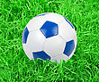 Soccer Ball On Green Grass Background stock photography