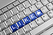 Social Network Concept . Keyboard With Blue Like Button. stock image