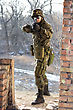 Soldier Near Wall With A Gun In His Hands stock photo