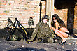 Soldier Resting With Sexy Playful Young Woman stock photo