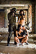 Terrorism Soldier And Two Sexy Women With Rifles In The Abandoned Building stock image