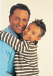 Son Hugging Dad stock photography