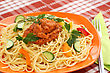 Vegetables Spaghetti Pasta With Sauce And Vegetables On Table stock photo