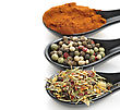 Spices In Black Spoons , Close Up stock photo
