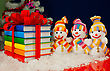 Stack Of Colorful Books Tied Up With Red Ribbon And Three Snowmen