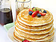 Top Stack Of Pancakes With Maple Syrup,honey And Berries stock photography