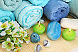 Stack Of Towels, Candles, Stones, Flowers On Mat Background. stock photography