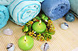 Stack Of Towels, Candles, Stones On Mat Background. stock photo