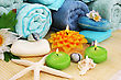 Stack Of Towels, Soaps, Candles, Stones, Flowers On Mat Background. stock photography