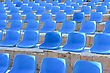 Stadium Blue Chairs At Sun Light stock image