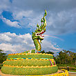 Rainbow Statue Of Asian Dragon On The Cloudy Sky Background stock photography