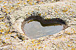 Stone Granite Heart With Puddle And Moss stock photo