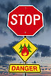 Signpost Stop Sign With Forest Fire Icon And Danger Warning Over Dark Sky stock image