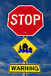 Stop Sign With House Under Flood Icon And Warning Over Dark Sky stock photo