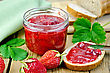 Strawberry Jam In A Glass Jar, Bread, Strawberry With Leaves, Napkin, Knife On Background Wooden Plank stock photography