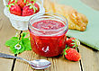 Strawberry Jam In A Glass Jar, Layered Bun, Strawberry, Napkin, Spoon On A Wooden Boards Background