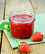 Strawberry Jam In A Glass Jar, Strawberries, Napkin On The Background Of Wooden Boards