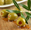Stuffed Green Olives On A Cutting Board