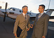 Successful Business Men with Private Plane stock photography